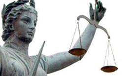 photo of statue of justice holding scales